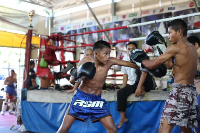 two fighters sparring at sangmorakot gym