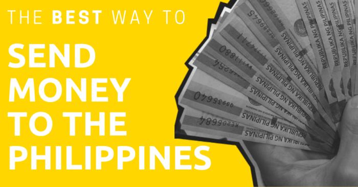 A hand fanning Philippine Pesos.