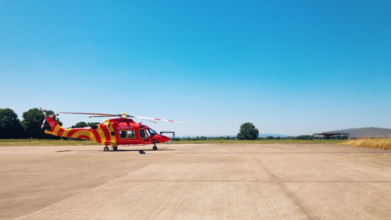 An air ambulance helicopter on a helipad.