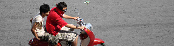 Red Shirts on Motorcycle