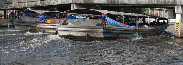 Thai Floods: Six Boats Pushing Flood Water