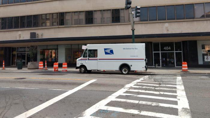 USPS truck parked alongside the street.
