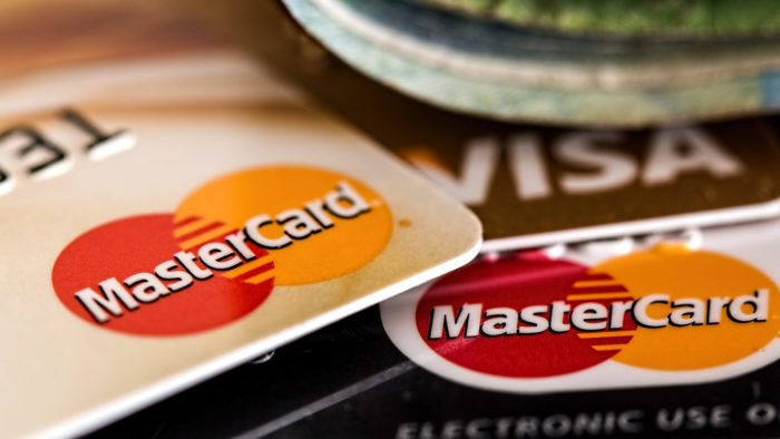 A stack of credit cards fanned out across a table.