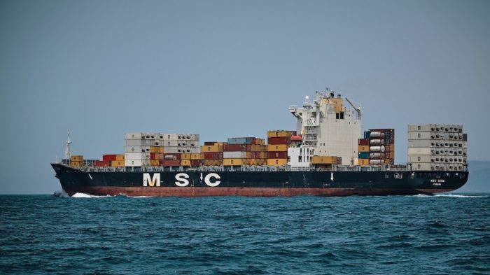 A shipping vessel leaving port.