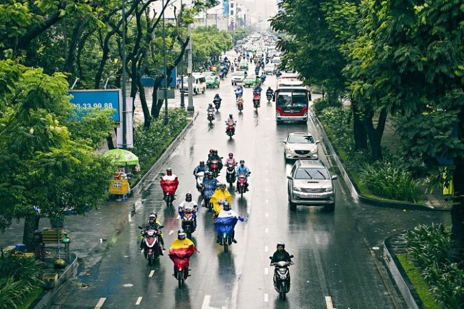 Riding a bike in Saigon during rainy season.